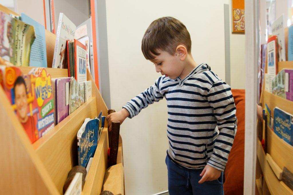child browsing books