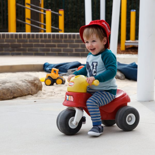 toddler on plastic trike