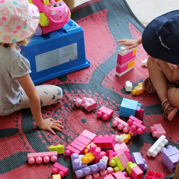 Girls playing with building blocks